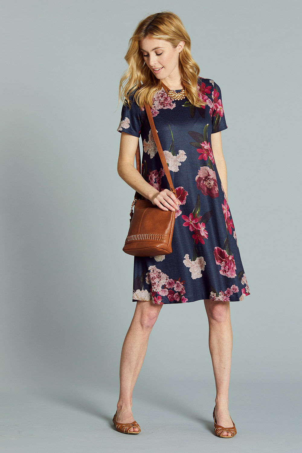 2db7459ec80a Soft Touch Printed Swing Dress. Hover to zoom